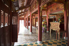 Old Chinese Buddhist temple. Hue, Vietnam. Old Chinese red wooden Buddhist temple in the Forbidden City of Hue, Vietnam royalty free stock photography