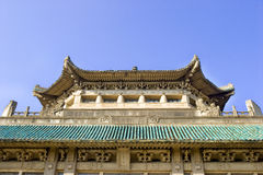 Old Chinese building. This building is now a library on a campus in Wuhan city of China.Its housetop was made of cyan blue glaze tiles,and there are eight Stock Photo