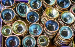 OLd Chinese Ceramic Glass Plates Panjuan Flea Market Beijing C. Hina. Panjuan Flea Curio market has many fakes, replicas and copies of older Chinese products royalty free stock photos