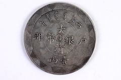 Old Chinese coin. Old Chinese silver coin isolated over white Royalty Free Stock Photo