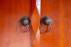 Old chinese door with lion's head door handles Stock Images
