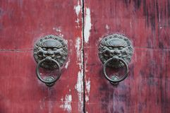Old chinese door. Old doorknob on vintage red door in China Royalty Free Stock Photography