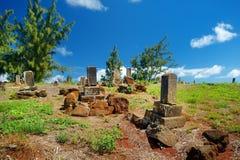 Old chinese grave headstones abandoned on Kauai Royalty Free Stock Image
