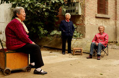 Old Chinese Ladies in Street by Homes, Keifeng Royalty Free Stock Photo