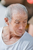 Old Chinese man dressed in a white T shirt, Beijing, China stock photo