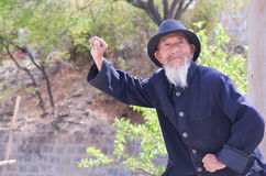 Old Chinese Man Kung Fu Demonstration. Old Chinese Man Provides Shaolin Kung Fu Demonstration in Luo Yang, China Stock Photo