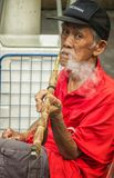 Old Chinese Man Smoking Stock Photography