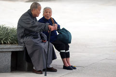 Old Chinese people. HONG KONG - FEB 21:Two old Chinese people talks in the park on February 21 2009 in Hong Kong, China.The population of the elderly in China is stock image