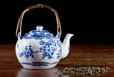 Old Chinese porcelain teapot,low key Royalty Free Stock Photos