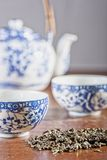 Old Chinese porcelain teapot, with two cups Royalty Free Stock Images