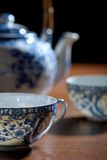 Old Chinese porcelain teapot, with two cups Royalty Free Stock Photography