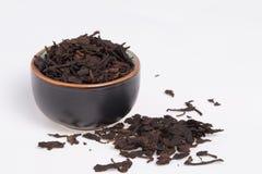 Old chinese Pu-Erh tea. Chinese Pu-Erh tea in dark cup.  Photo taken on: January 17th, 2014 Stock Photos