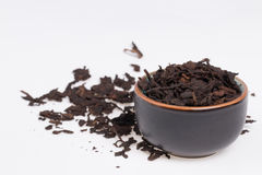 Old chinese Pu-Erh tea. Chinese Pu-Erh tea in dark cup.  Photo taken on: January 17th, 2014 Royalty Free Stock Photos