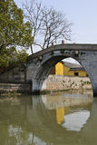 An old stone bridge. An old chinese stone bridge with one large bridge arch Royalty Free Stock Photos