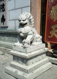 Old Chinese Stone lion the guardian  at the entrace of  Wat Leng Noei Yi Stock Photo