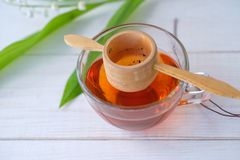 Chinese tea Shen Puer and Lily of the valley Royalty Free Stock Photo