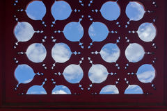 Old Chinese window. Old red Chinese window with blue sky and white cloud Royalty Free Stock Photography