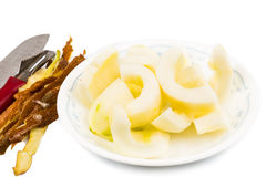Old Chinese yellow cucumber with skin peeled and cut into portions as cooking ingredient Stock Photos