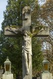 Old christian cross. Old christain cross made of stone with Jesus on it stock images