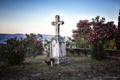 Old christian cross. In the yard of abandoned house Royalty Free Stock Image