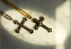Two decorated christian crosses. Old christian crosses with rich decorations with a chains Stock Photos
