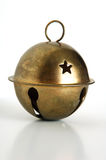 Old Christmas bell. A tarnished, brass Christmas bell on a white background royalty free stock photography
