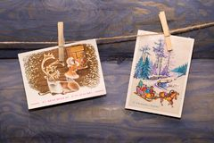Old Christmas cards. Hanging on the rope clothes pegs Stock Image