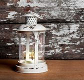 Old Christmas lantern on background of  old brick wall Royalty Free Stock Photo