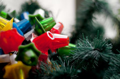 OLd Christmas lights. On artificial fir branches. Shallow depth of field Royalty Free Stock Images
