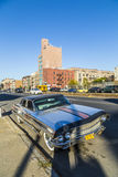 Old chrome cadillac car parks on the street in New York Stock Images