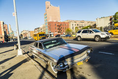 Old chrome cadillac car parks on the street in New York Stock Photos