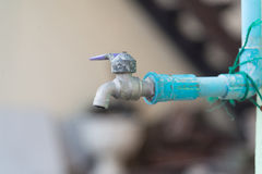 Old chrome faucet and water pipeline. Royalty Free Stock Photo