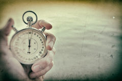 Old Chronometer. In man hand, vintage  style Royalty Free Stock Images