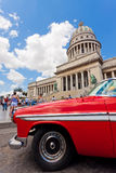 Old Chrysler in front of the Capitol in Havana. Cubans keep thousands of classic cars like this running despite their age and they've become an world known icon Royalty Free Stock Photography