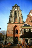 The old church Aa-kerk or The Der Aa Church. The Der Aa Church with its striking yellow tower and medieval arches is one of the most iconic buildings in Royalty Free Stock Photography