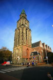 The old church Aa-kerk or The Der Aa Church. The Der Aa Church with its striking yellow tower and medieval arches is one of the most iconic buildings in Stock Photo