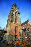 The old church Aa-kerk or The Der Aa Church. The Der Aa Church with its striking yellow tower and medieval arches is one of the most iconic buildings in Stock Photography