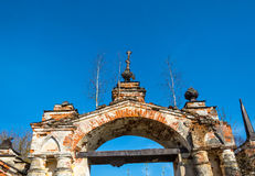 Old Church archway, overgrown with birches, Russia. Old Church arch of red brick, overgrown with birches on a background blue sky, Russia Stock Photos