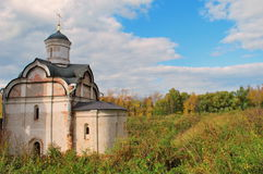 The old church on the background of the autumn forest Stock Photos