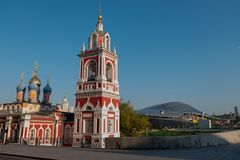 The old Church on the background of modern buildings. royalty free stock photography