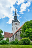 Old church behind trees in tallinn Royalty Free Stock Photography