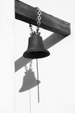 Old church bell. Against wall with shadow Stock Photography