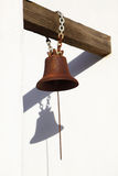 Old church bell. Against wall with shadow Royalty Free Stock Photo