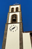The old church bell tower against the blue sky Royalty Free Stock Photography