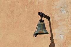 Old church bell on wall Royalty Free Stock Image