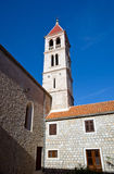 Old church belltower in village Stock Photography