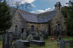 Old church in Bewst Y Coed. The historic St Michaels church and grave yard on the edge of the North Wales village Betws y Coed stock images
