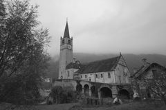 The old church. Black and white photo of a medieval church with tower bell, dedicated to Madonna of Lourdes, located in a small mountain village in north of royalty free stock image