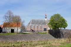 Old church with a cannon in Schokland (Unesco), a former island in the Noordoostpolder, Netherlands Stock Photo