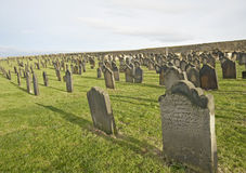Old church cemetary with headstones Royalty Free Stock Photo